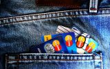 Assortment of credict cards in the jeans back pocket